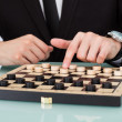 Close-up Businessman Playing Checkers At Office De...