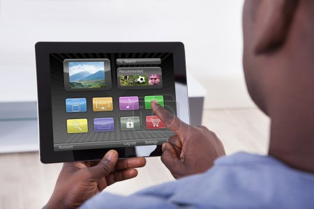 Person Holding Digital Tablet