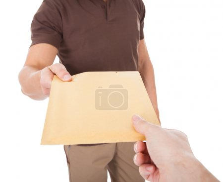 Photo for Close-up Of Mailman Delivering Mail To Person Over White Background - Royalty Free Image