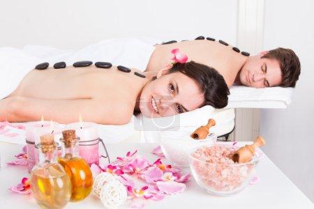 Couple Enjoying A Lastone Massage