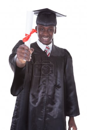 Photo for Portrait Of Graduation Man With Diploma Over White Background - Royalty Free Image