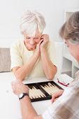 Senior Couple Playing Backgammon