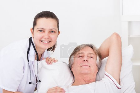 Female Doctor With Senior Male Patient