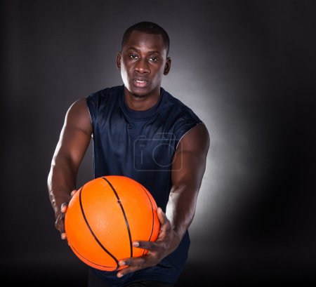 African Young Man With Basketball
