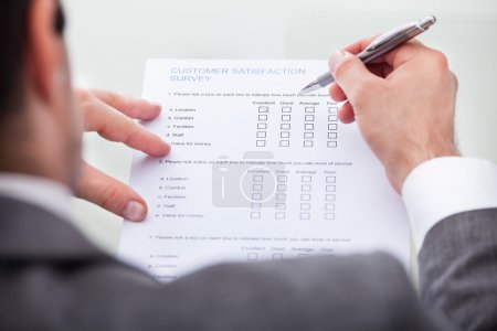 Businessman Filling Customer Survey Form