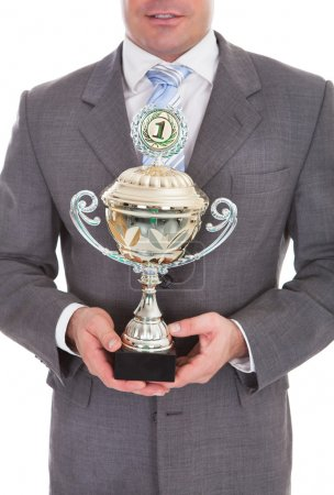 Businessman Holding Trophy