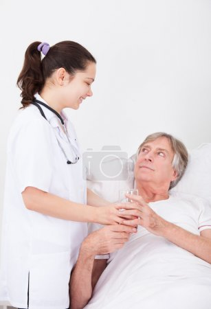 Doctor Giving Water To Patient