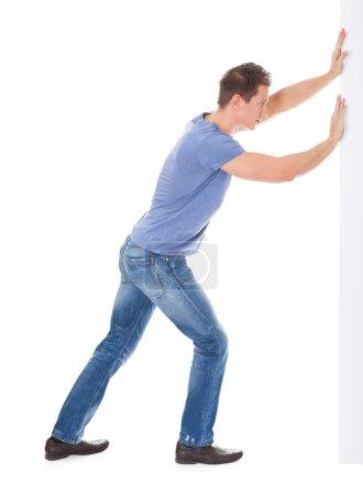 Young Man Pushing Placard