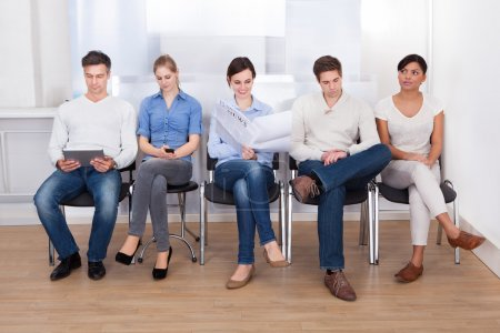 People Waiting In A Room