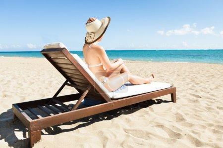 Woman In Bikini Relaxing On Deck Chair