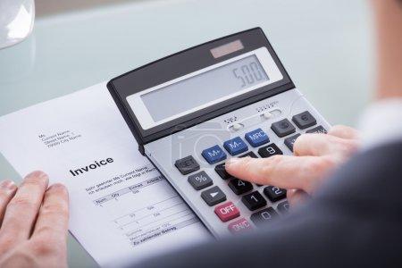 Businessperson Doing Calculation