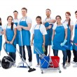 Large diverse group of janitors wearing blue apron...