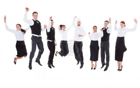 Photo for Waiters and waitresses jumping over white background - Royalty Free Image