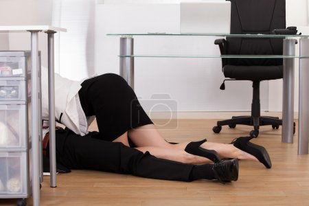 Low Section Of Business Couple Getting Intimate On Floor
