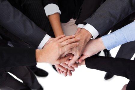 Photo pour Angle haut gros plan de mains empilement de gens affaires - image libre de droit