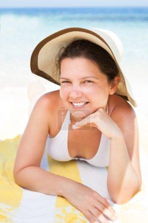 Woman In Bikini Top Lying On Beach Towel