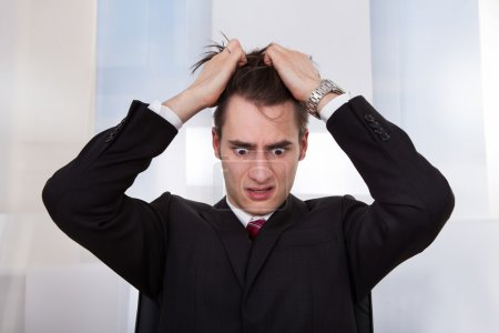Confused Businessman Pulling Hair