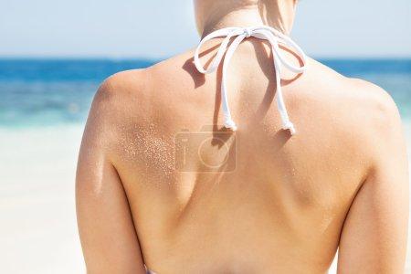 Woman In Bikini Top Standing At Beach