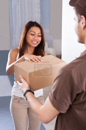 Woman Receiving Courier From Delivery Man