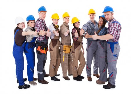 Diverse group of workmen giving a thumbs up
