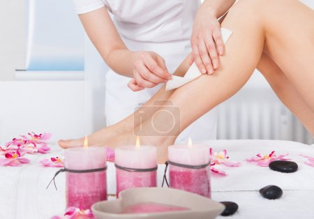 Photo for Close-up Of A Woman Getting Thigh Massage Treatment At Spa - Royalty Free Image