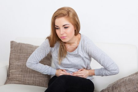 Photo for Portrait Of Young Woman With Pain In Her Stomach - Royalty Free Image