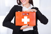 Businesswoman Holding First Aid Box