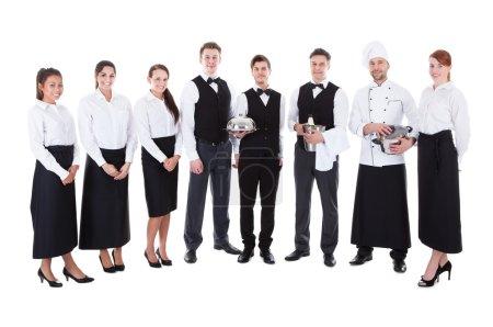 Photo for Large group of waiters and waitresses. Isolated on white - Royalty Free Image