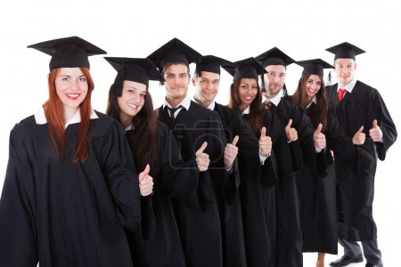 Graduate students standing in row showing thumbs up