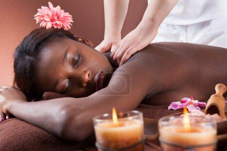 Woman Receiving Shoulder Massage At Spa