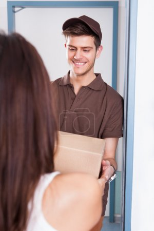 Delivery Man Giving Courier To Woman