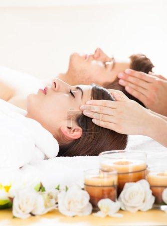 couple receiving head massage