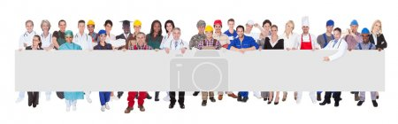 Photo for People with various occupations holding blank billboard against white background - Royalty Free Image
