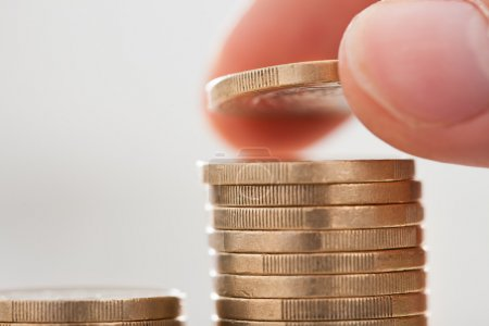 Businessman Hand Stacking Coins In Office