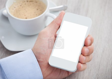 Businessman's Hand Holding Cellphone With Blank Screen