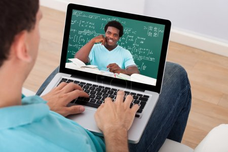 Man Attending Online Math's Lecture At Home