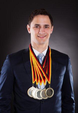 Smiling Businessman Wearing Medals
