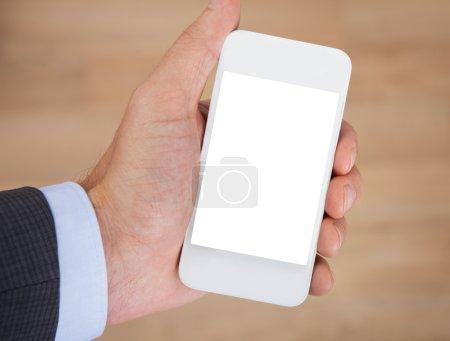 Photo pour Gros plan de main tenant smartphone avec écran vierge - image libre de droit