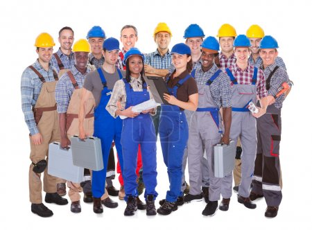 Panoramic shot of confident manual workers standin...