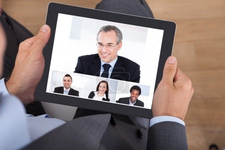 Businessman Video Conferencing With Coworkers