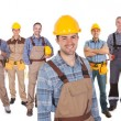 Portrait of happy construction worker with colleag...