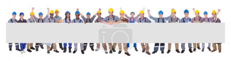 Portrait of successful manual workers with blank b...