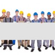 Portrait of multiethnic manual workers holding bla...