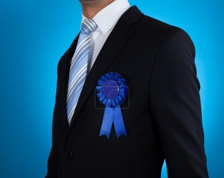 Midsection Of Businessman With Ribbon