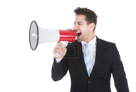 Businessman Screaming Into Megaphone