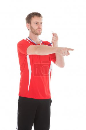 Referee Pointing While Holding Whistle