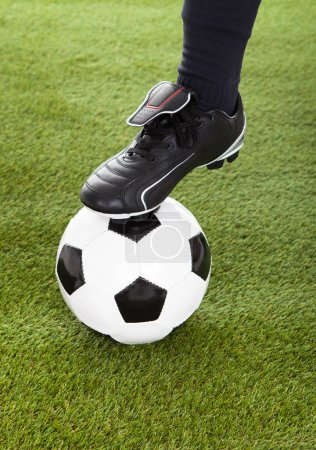 Player's Leg On Soccer Ball
