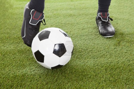 Player's Leg On Soccer Ball