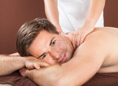 man receiving back massaging