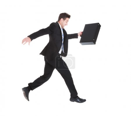 Photo pour Vue latérale pleine longueur de l'homme d'affaires avec valise sur fond blanc - image libre de droit